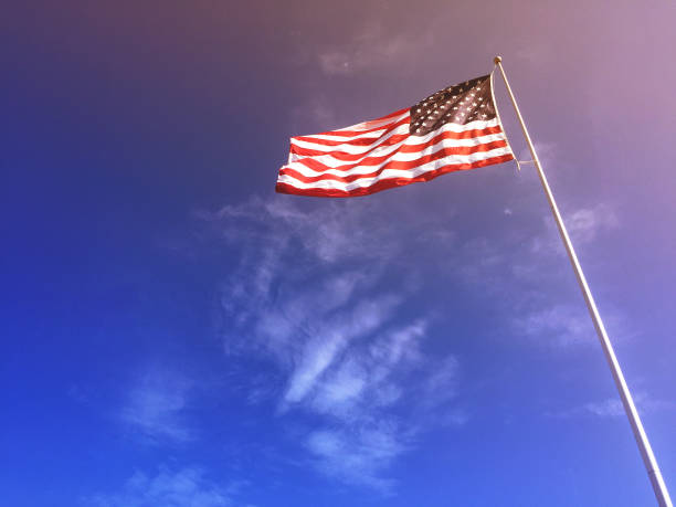 American Flag Blowing in the Wind stock photo