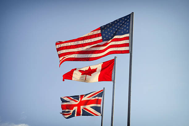 American Flag, Canadian Flag and Flag of Great Britain stock photo