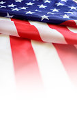 Image of closed up of American Flag with star and strips unfurled in the wind.