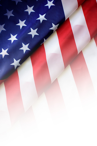 Image of closed up of American Flag with star and strips background.