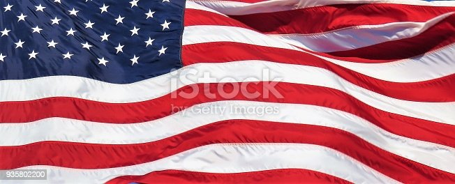 579407234istockphoto American flag close-up, background 935802200