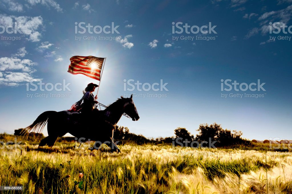 American Flag Cowgirl stock photo