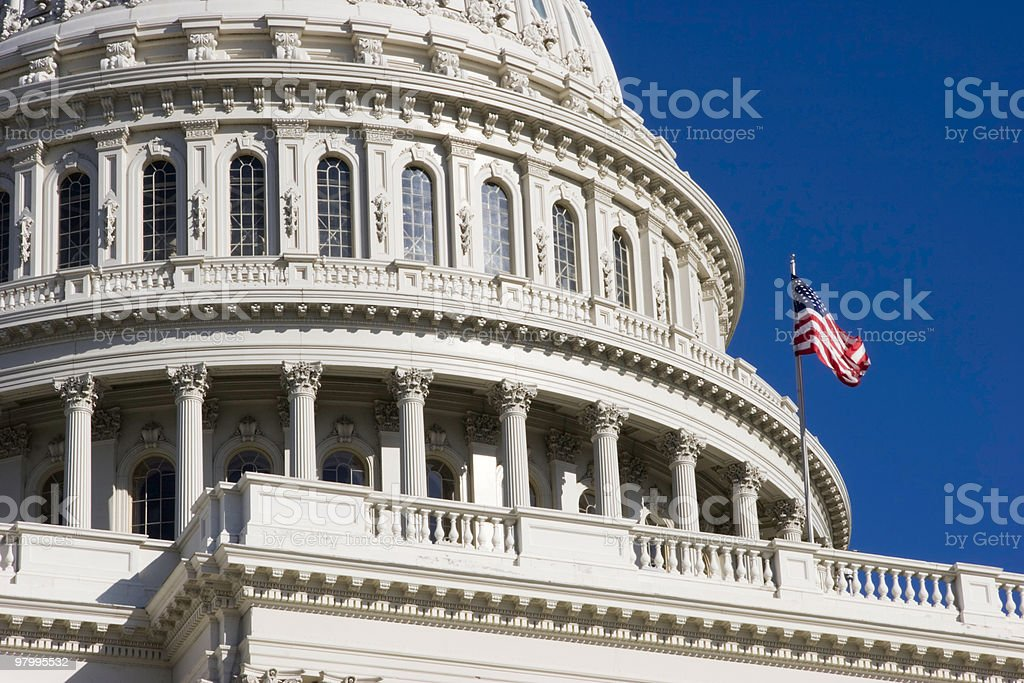 American Flag Flies Over Capitol Dome royalty free stockfoto