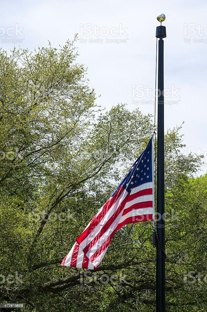 American Flag Flying at Half Mast stock photo