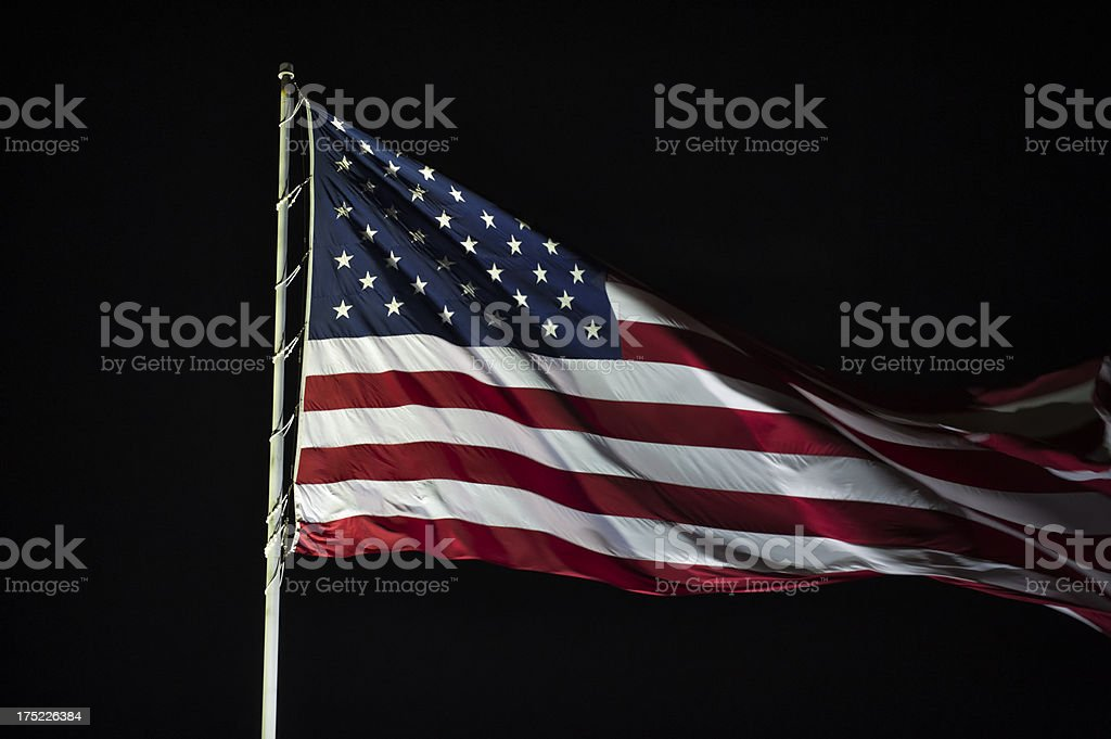 American Flag Flying at Night Close Up stock photo