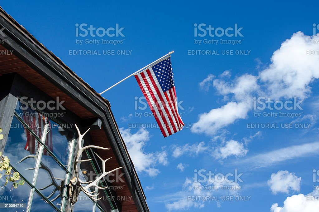 American Flag Flying in Vail Village in Vail, Colorado stock photo