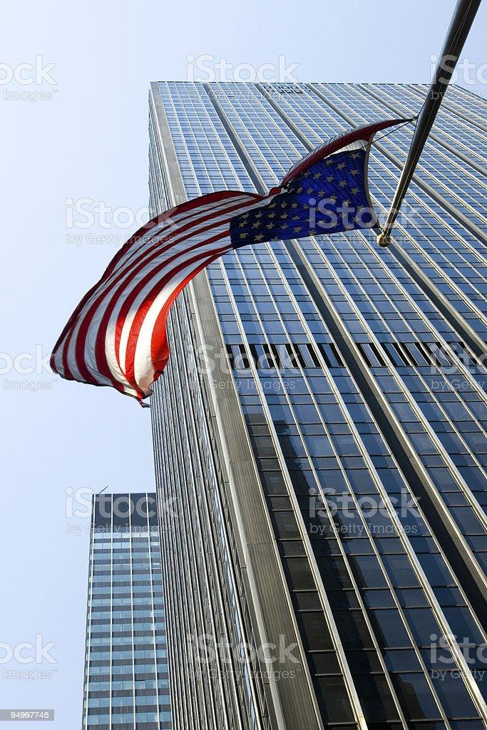 American flag flying over Manhattan royalty-free stock photo