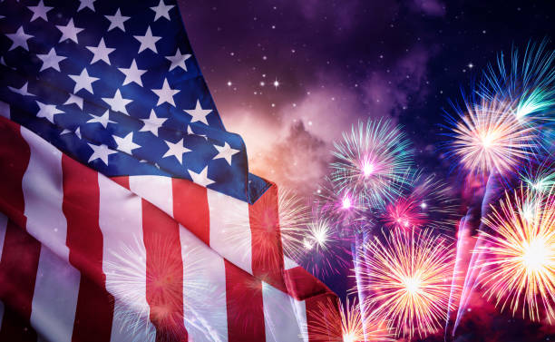 American flag for Memorial Day or 4th of July. American flag and fireworks with night sky background. firework display stock pictures, royalty-free photos & images