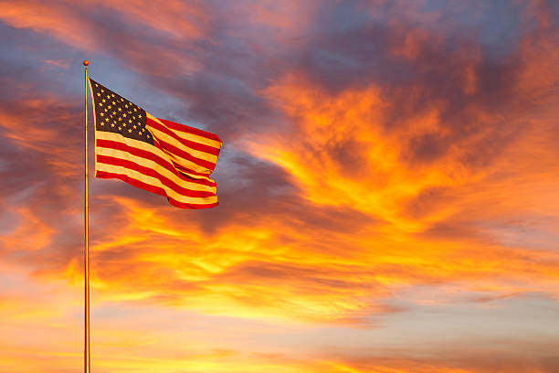 American flag glow in sunset (P) stock photo