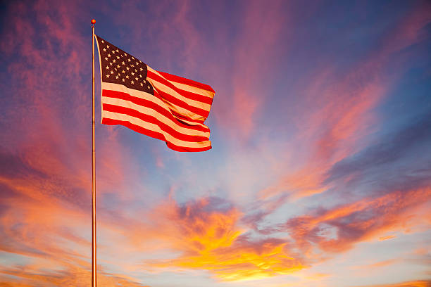 American Flag glows in the sunset. (P) stock photo