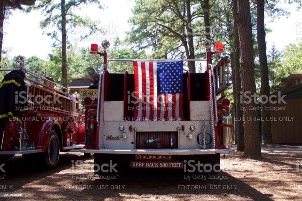 American flag hanging from back of Mack fire truck stock photo