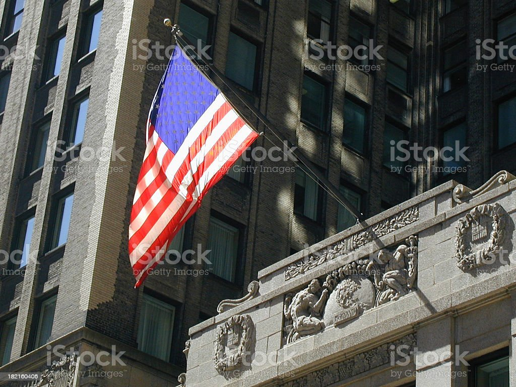 American Flag Hanging From the Top of A Building royalty-free stock photo