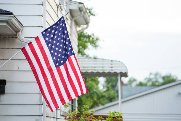 American Flag Hanging Outside of Home, Fourth of July stock photo