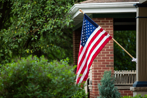 American Flag Hanging Outside Of Home Fourth Of July Stock