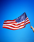 istock American flag holding in hand 924710826