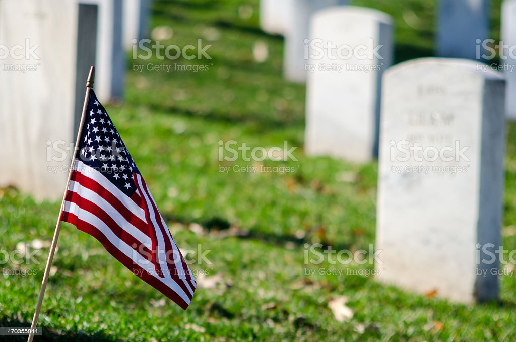 American flag in a cemetery stock photo