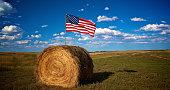 istock American flag in bale of hay in farm field 688331890