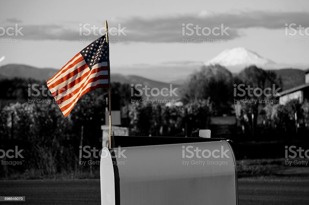 American Flag in color with black and white background stock photo