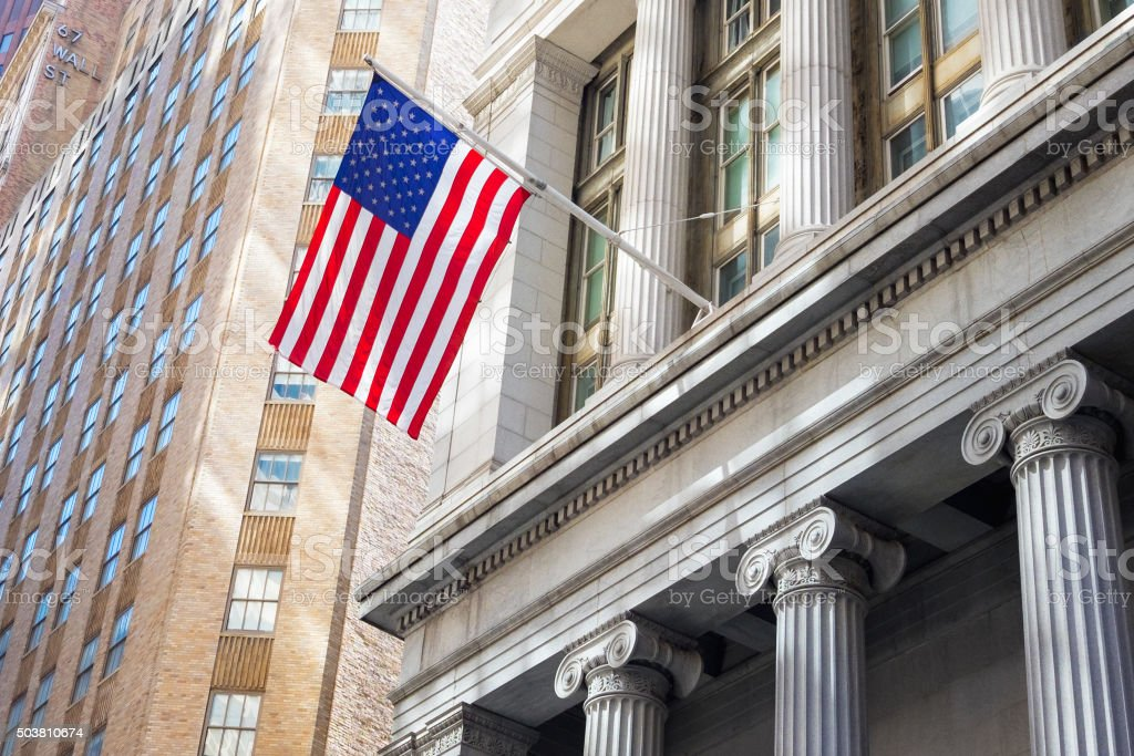American flag in financial district, New York stock photo