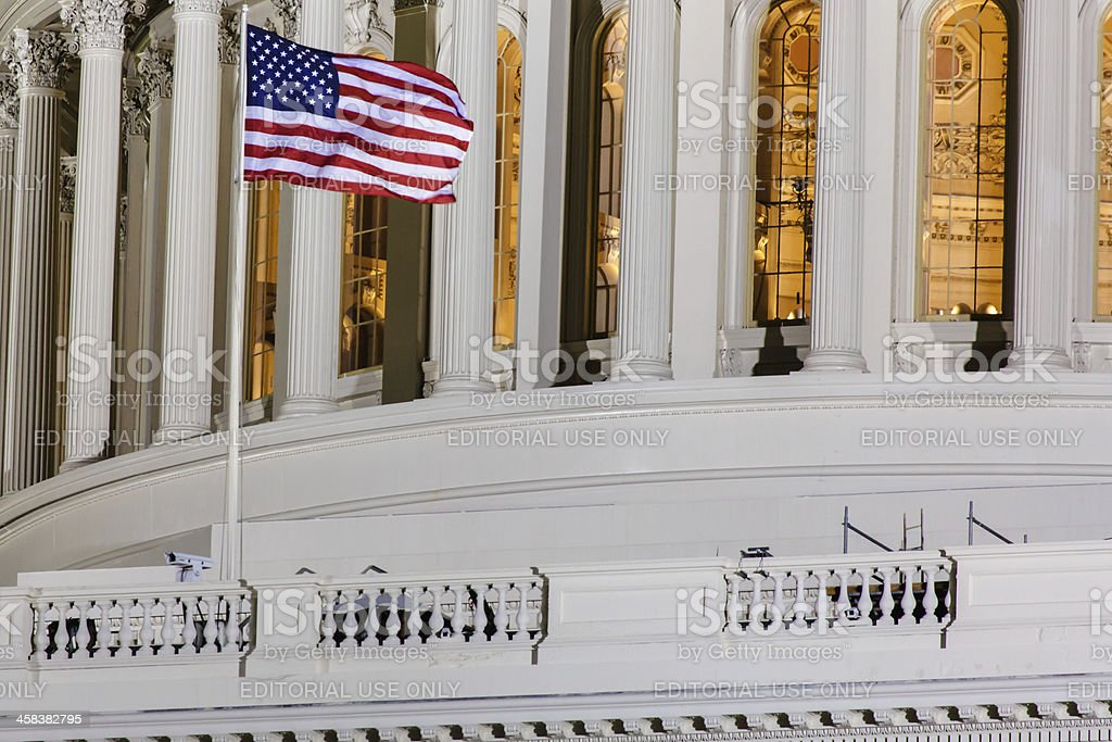 American Flag in front at United States Capitol stock photo