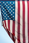 istock American flag in front of a city 638139442