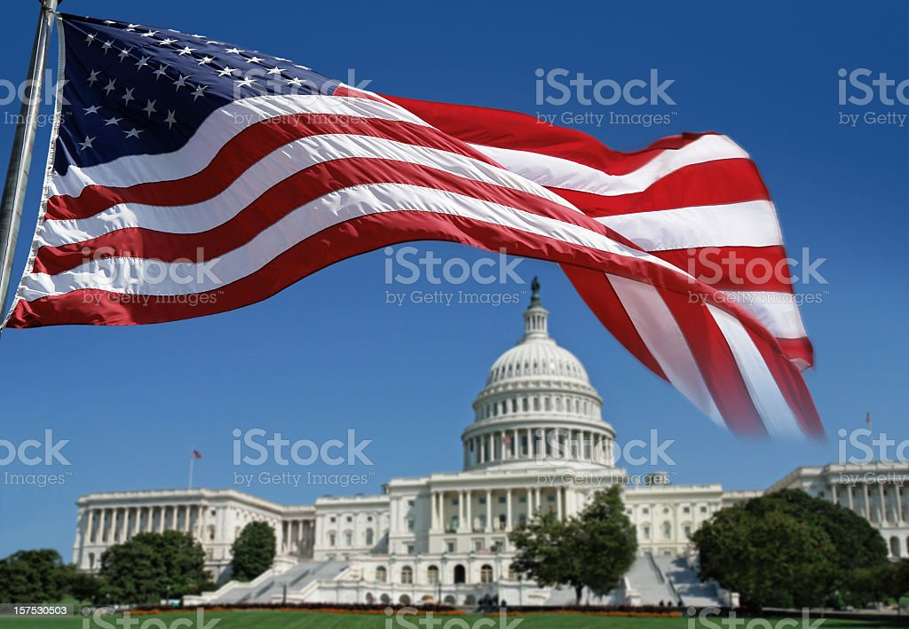American Flag in front of The Capitol stock photo