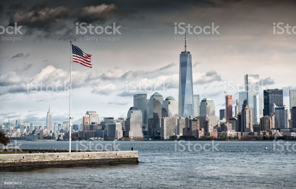 American Flag in front of the New York financial district stock photo