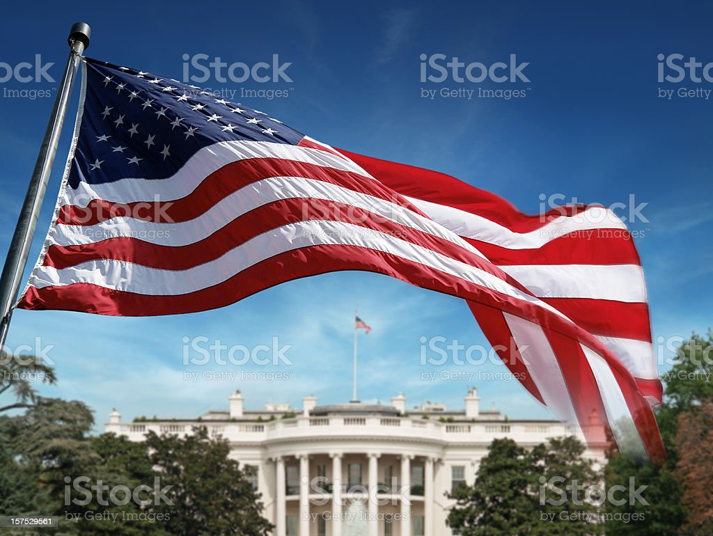 American Flag in front of The White House stock photo