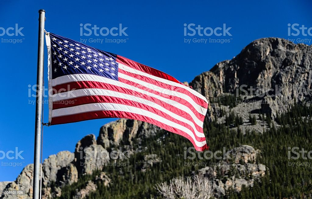 American Flag in Rocky Mountains stock photo