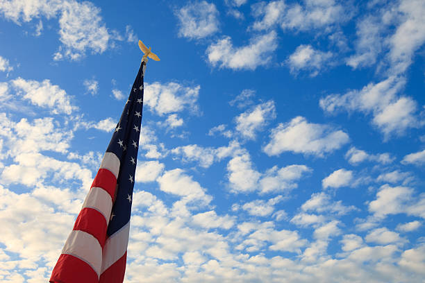American Flag in the Clouds stock photo