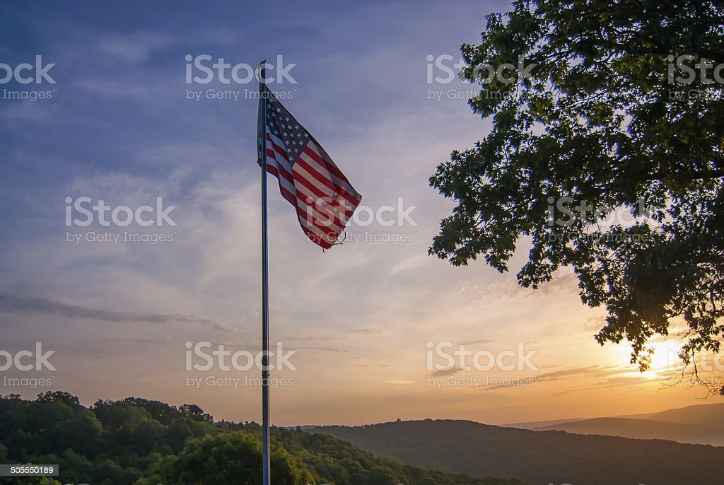 American flag in the sunrise stock photo