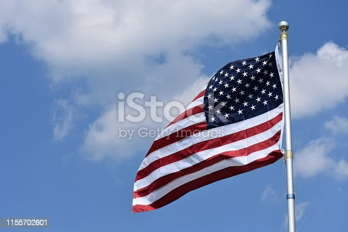istock American flag in wind 1155702601