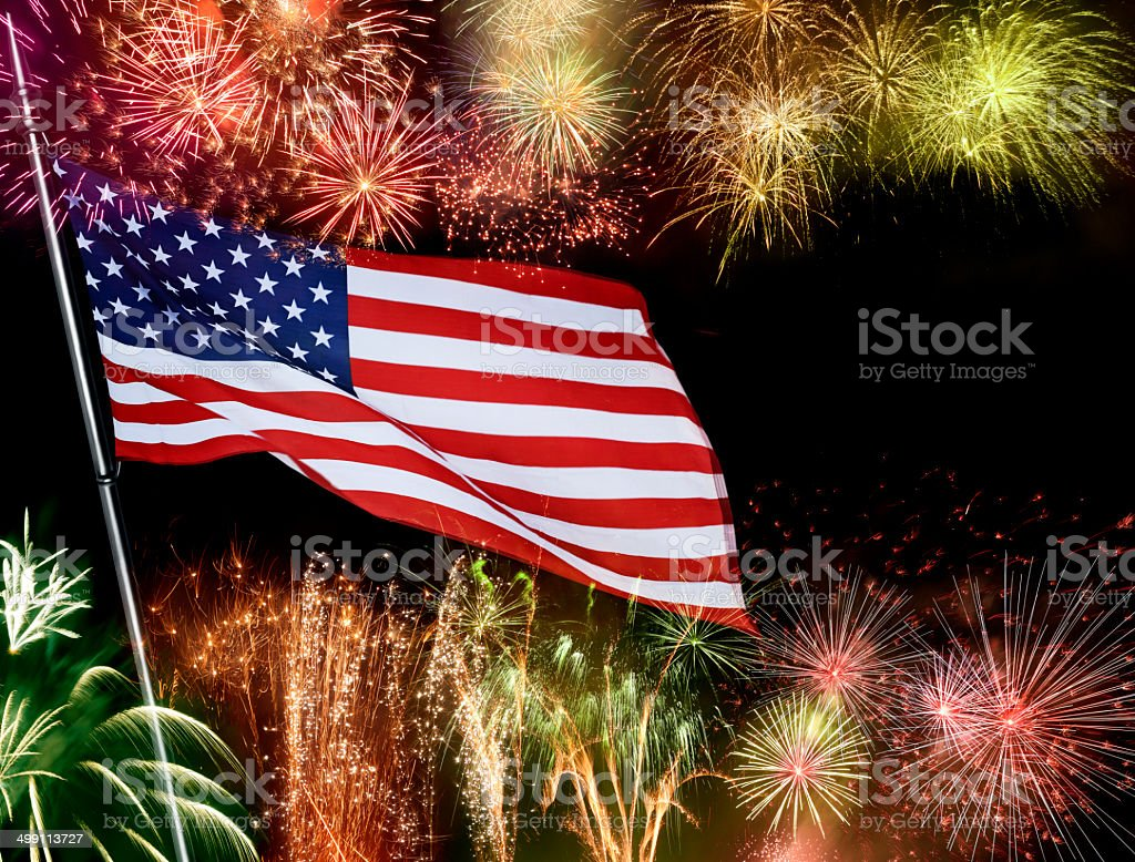 American Flag Infront Of Fireworks stock photo