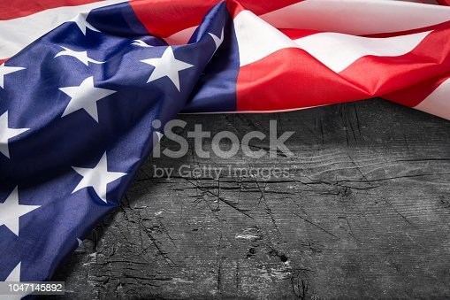 istock American flag lying on old wooden board 1047145892