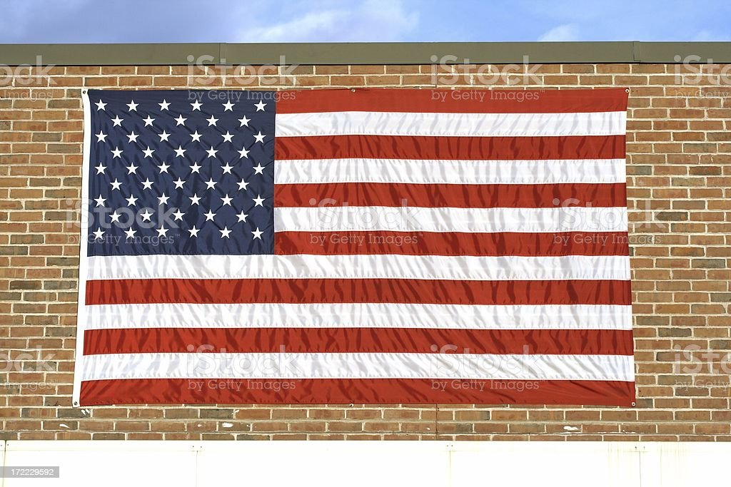 American Flag Mounted on Brick Wall royalty-free stock photo