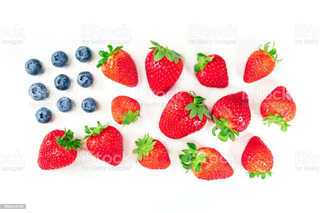 American flag of blueberries and strawberries on white stock photo