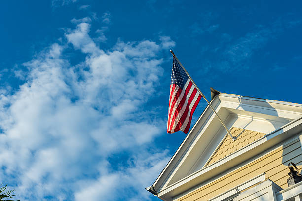 american flag on a building stock photo