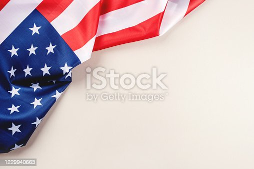 istock American flag on a gray background. 1229940663