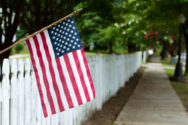 american flag on a picket fence - happy 4th of july stock pictures, royalty-free photos & images