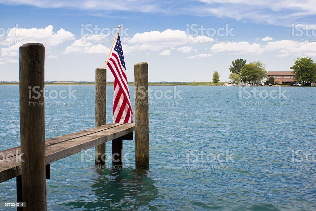 American flag on a pontoon on a lake stock photo