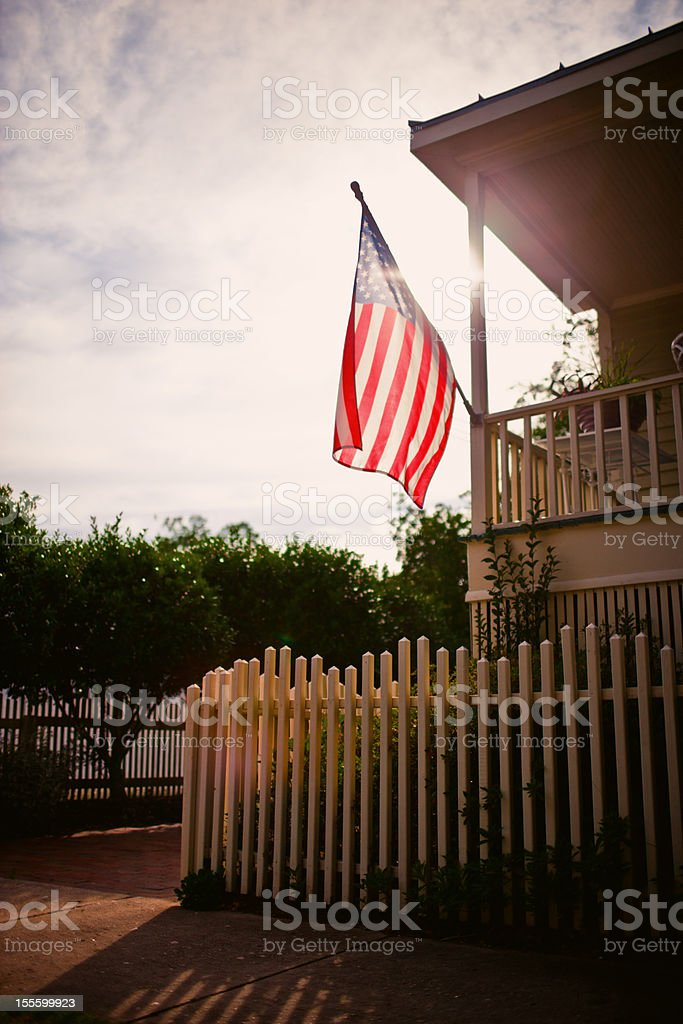 American Flag on a rural house stock photo
