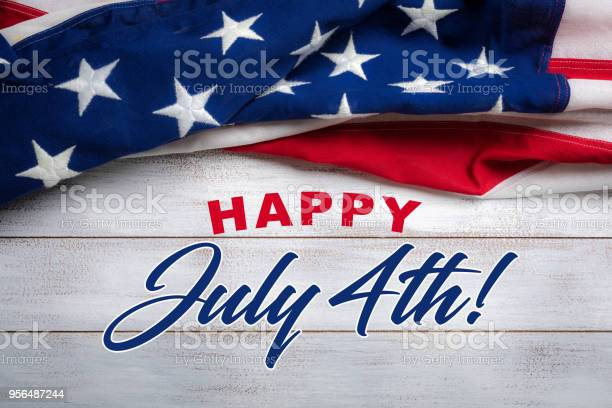 American Flag On A White Worn Wooden Background With July 4th Greeting Stock Photo - Download Image Now