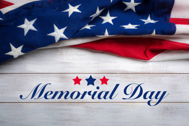 american flag on a white worn wooden background with memorial day greeting - memorial day стоковые фото и изображения