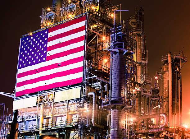 american flag on an oil refinery - halbergman stock pictures, royalty-free photos & images