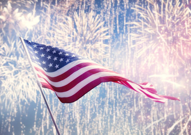 American flag on background of fireworks. stock photo