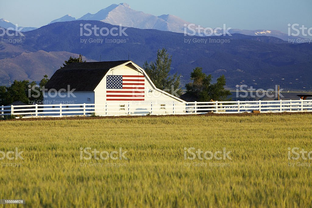 American Flag on Barn in Rocky Mountains stock photo