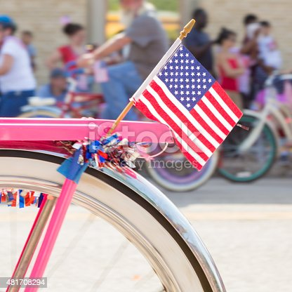 istock American flag on bicycle during parade on Fourth of July 481708294