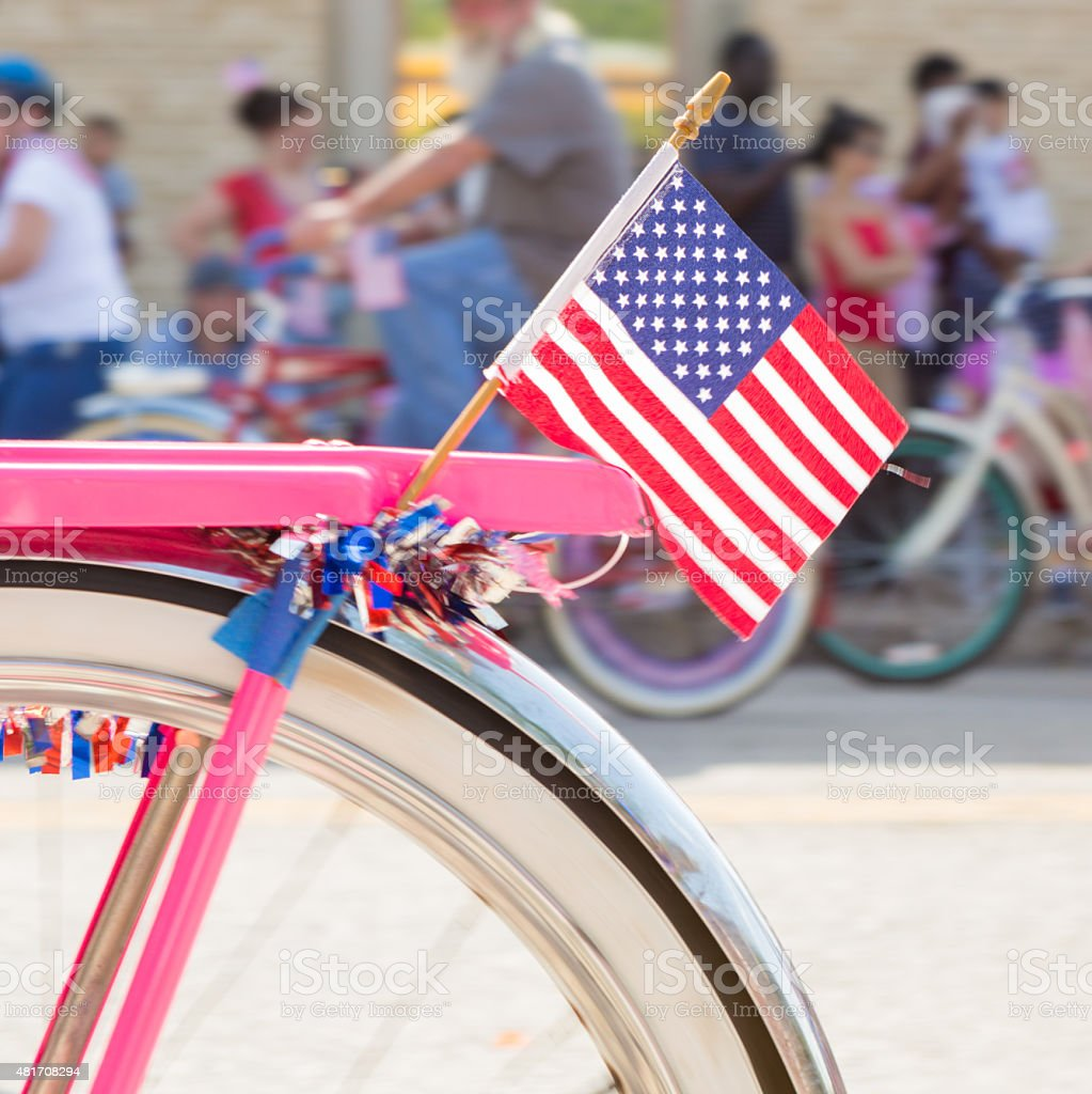 American flag on bicycle during parade on Fourth of July stock photo