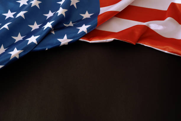 American flag on black background with copy space The American flag ruffled on black paper cardboard backdrop with copy space day 4 stock pictures, royalty-free photos & images