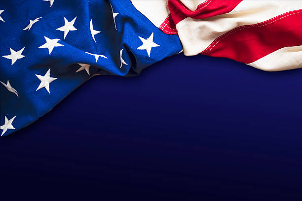 XXXL American flag on blue background stock photo